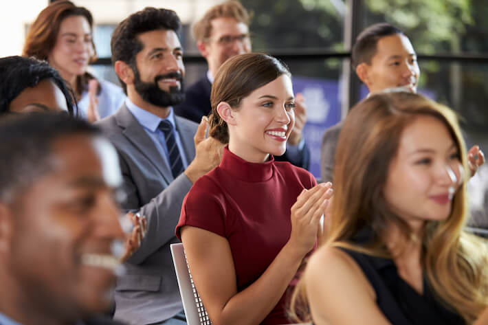 Audience Applauding At A Seminar